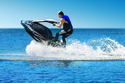 Many people like to do tricks on jet skiis like the one seen in this picture; however, these tricks often lead to injuries and boating accidents. Contact a Baton Rouge boating accident lawyer or Louisiana jet ski lawyer today.
