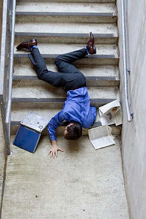 This picture is a simulation of what it may look like when a man falls down stairs. Slip and fall accidents, sometimes referred to as trip and falls, are covered by an area of law called premises liability. Contact a Baton Rouge premises liability attorney today to represent you in your slip & fall injury claim.